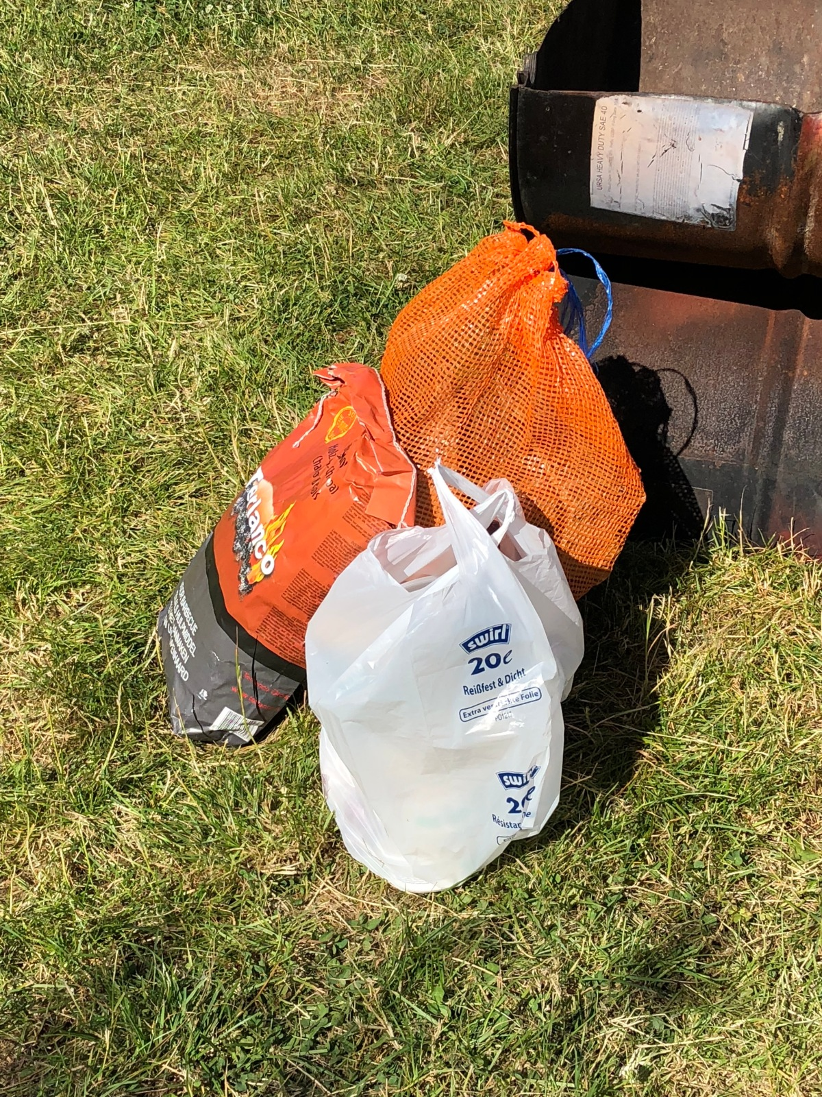 The firewood, BBQ charcoal, and the food packet