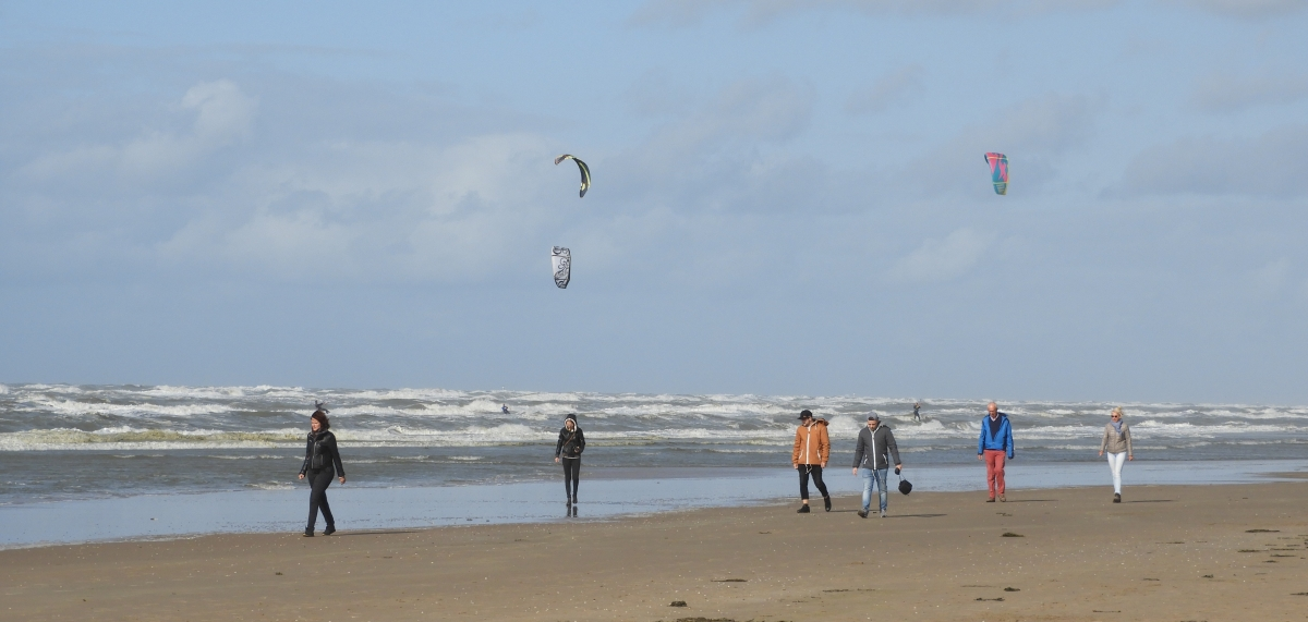 Kite surfers and beach walkers at Zandvoort