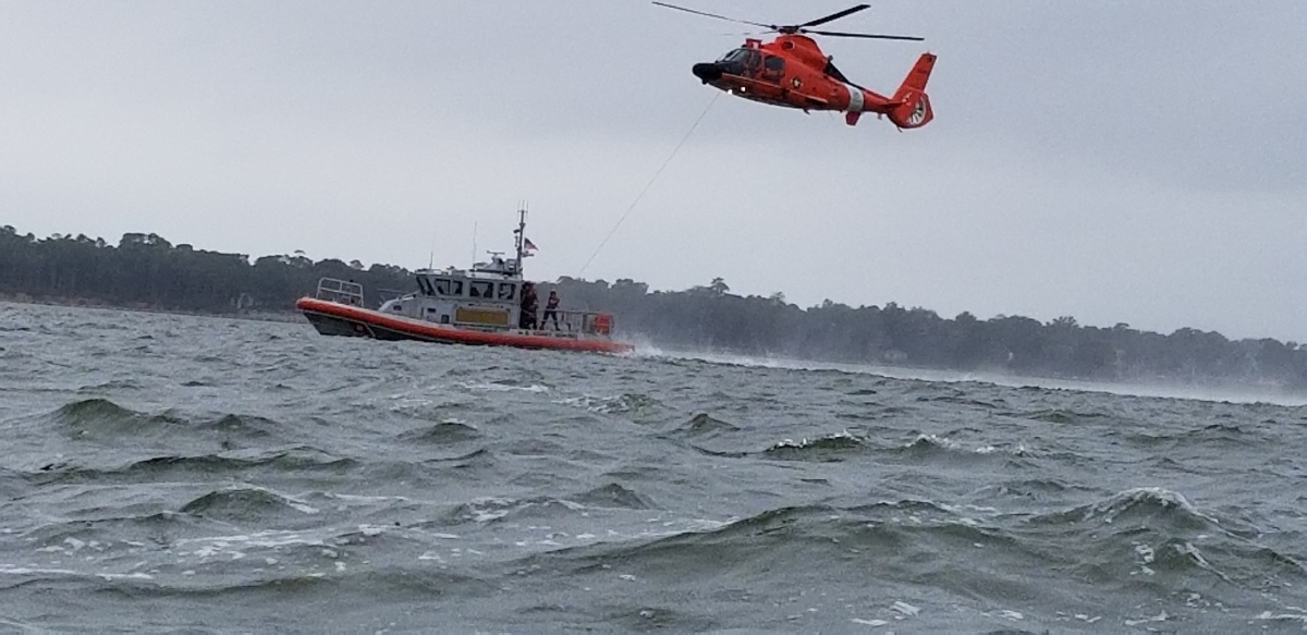 Waves and spray as the Coast Guard practiced a rescue