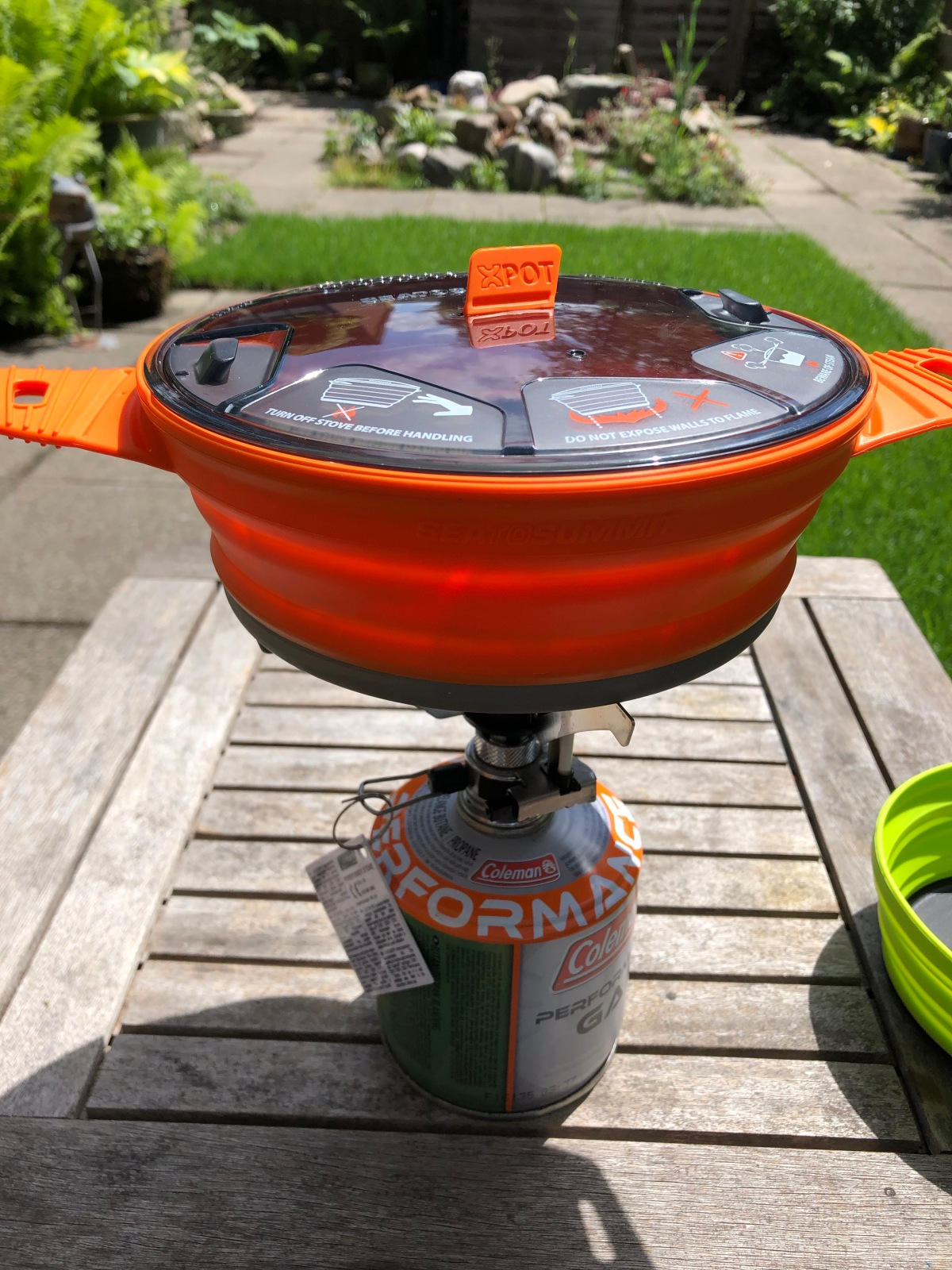 Fits well on the camp stove - Warning that lid must not be secured while cooking.