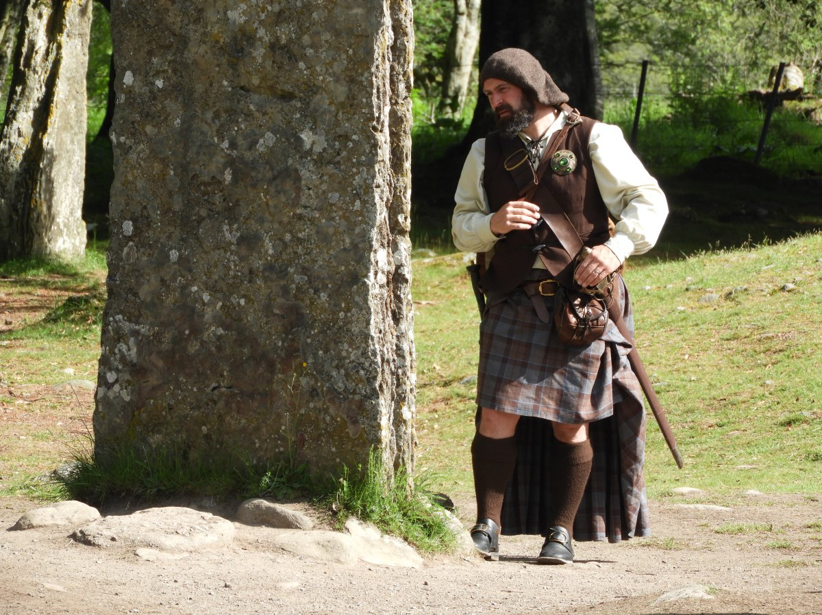 One of the local Scottish Highlander tour guides waiting for the next volunteer from his group