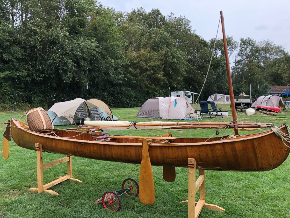 Wood canoe rigged with a sail