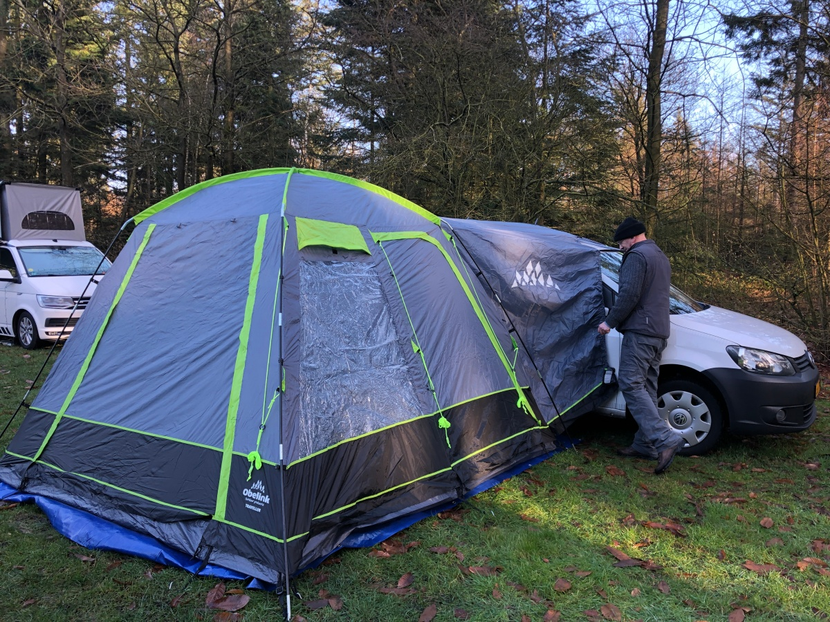 The new tent, making final adjustments