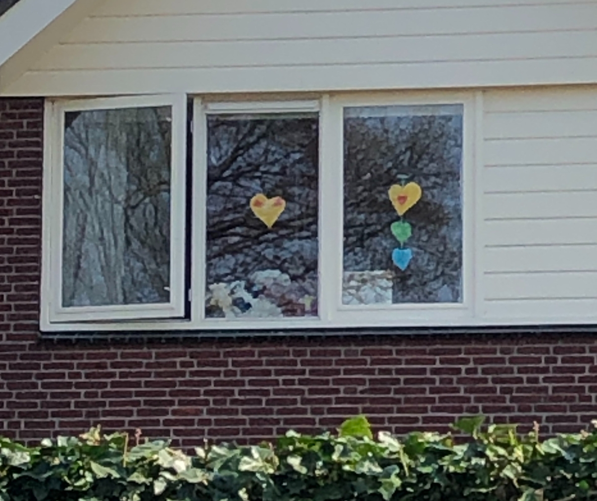 I found hearts in this window on my afternoon walk